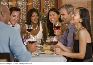 Multi-ethnic friends eating at restaurant